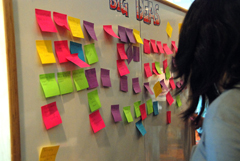 A brainstorming activity using post-it notes - during an innovation lab collaborative event.